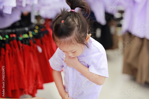 Cute little girl try dressing school uniform, Kindergarten children
