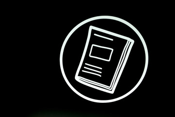 White book icon on black background.