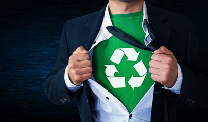 Businessman tearing off shirt with recycle sign.