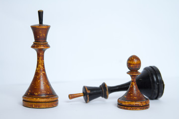Old chess Board with wooden pieces.