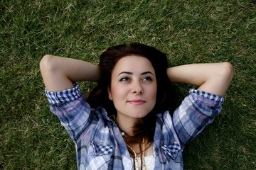Woman feeling good on grass