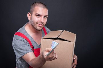 Mover man holding box showing some money