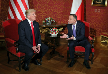 U.S. President Donald Trump talks with Polish President Andrzej Duda during their bilateral meeting in Warsaw