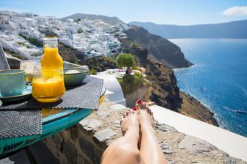 Woman enjoying morning in beautiful Santorini