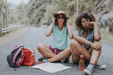friends travel on the road with expression of fatigue