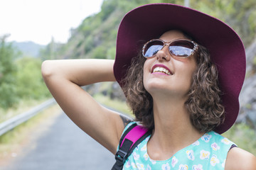 portrait of girl with sunglasses and hat in shorts