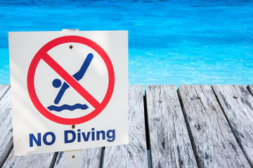 warning sign for safety at swimming pool..