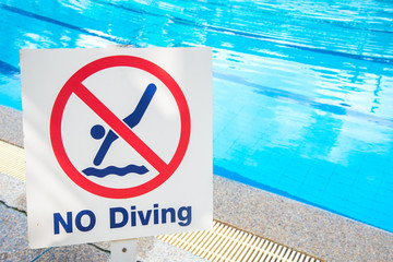 warning sign for safety at swimming pool.