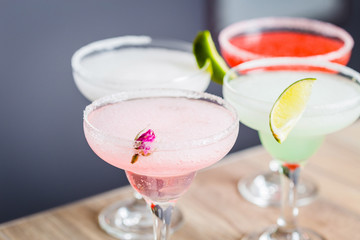 Different Kind of Cocktails garnished with Fruits, Strawberry, Lime, Pineapple and Rose Flower Cocktails, Focus on Foreground, Horizontal View