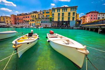 Peschiera del Garda colorful harbor and boats view Wall mural