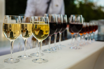 Glasses with wine on a buffet table