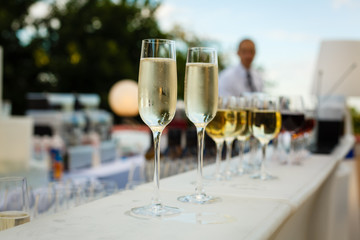 Two glasses of champagne on a buffet table