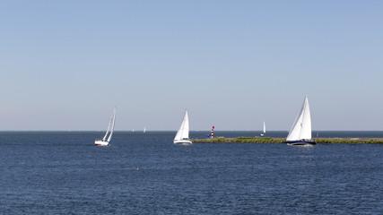 Sailing boats near entrance of harbor, Lelystad, Flevoland, Netherlands