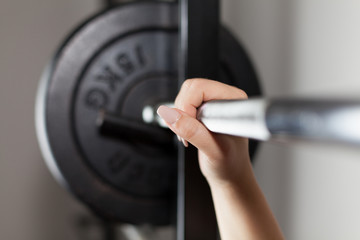 woman's hand on a barbell
