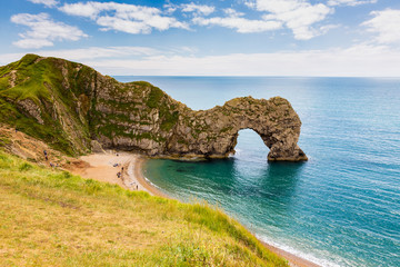 Photo Stands Coast Durdle Door, travel attraction on South England, Dorset