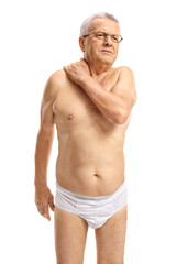 Mature man in underwear suffering from neck pain