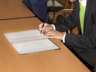 Wedding ceremony. Wedding groom leaving his signature