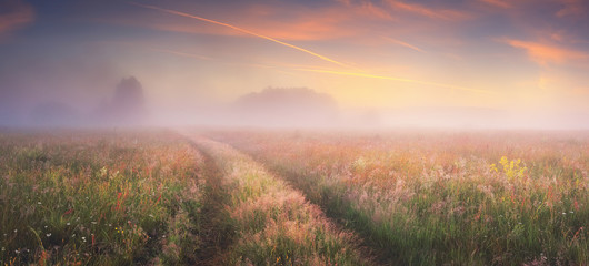 Aluminium Prints Village Bright sunrise on autumn meadow