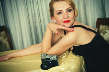 Vintage woman portrait with camera