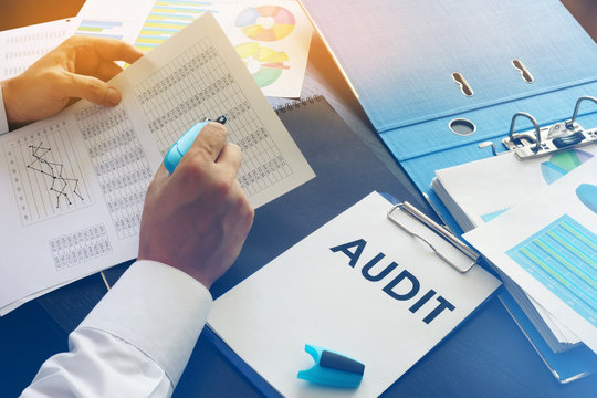 Document with title Audit on an office table.