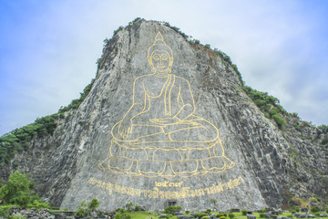 Golden Buddha laser carved and inlayed with gold on Khao Chi Chan Cliff, Pattaya, Chonburi, Thailand,Buddha Mountain