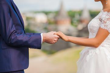 wedding couple holding hands, love