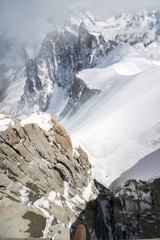 a small step to landscape at the aiguille du midi peak covered with snow