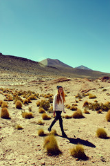 young skinny woman walking in Andean highlands, Bolivia