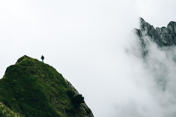 Single wanderer on a hill in the Switzerland Mountains
