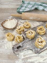 Italian homemade pasta on a wooden board.