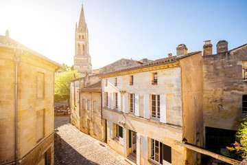 Street view in Saint Emilion village with church tower during the sunset in France Wall mural