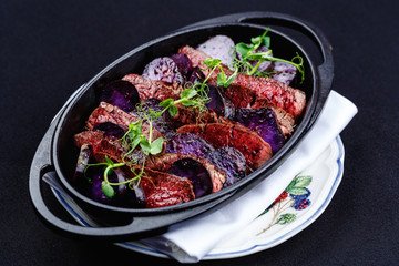 Stew meat with slices of beetroot on the brazier.