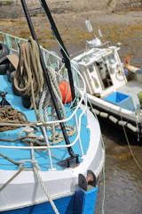 Close-up on fishing boats in the Portree fishing harbor, Isle of Skye, Highlands, Scotland, UK