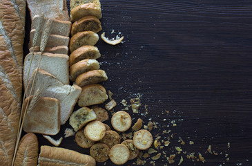 Pile of expire breads on dark wooden background / Still life image and selective focus and space for text.