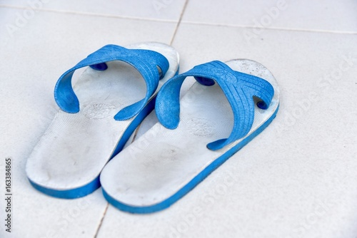 a9b383713b14 A Pair of Old Blue Sandals Isolated on the Floor