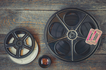 Reel with the film and movie tickets