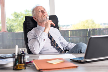 Portrait of thoughtful businessman sitting