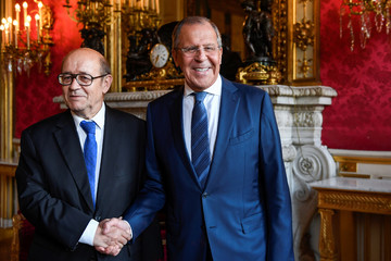 French Foreign Minister Jean-Yves Le Drian greets his Russian counterpart Sergei Lavrov upon his arrival for their talks on Ukraine and Syria, at the Foreign Ministry in Paris