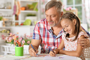 Father and daughter  drawing picture