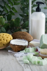 Indulge in skin care luxury with homemade soap and coconut milk body wash lotion - vertical with room for text