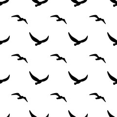 Seamless patterns image silhouettes of birds. Vector illustration. Marine theme. Birds,seagull are flying. Modern stylish abstract texture. Template for prints, textile, wrapping and decoration.