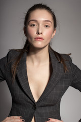 Portrait of gorgeous young caucasian attractive sexy business woman or secretary wearing checked jacket