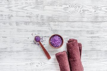 Lavender bath salt on wooden background top view copyspace