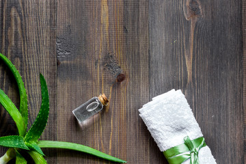 Organic aloe vera cosmetics. Aloe vera leafs and spa lotion on wooden table background top view copyspace