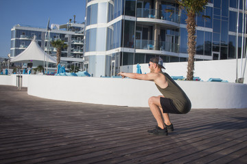 Handsome man do morning  exercise near the beautiful hotel in sunny day