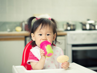 baby girl eating at home