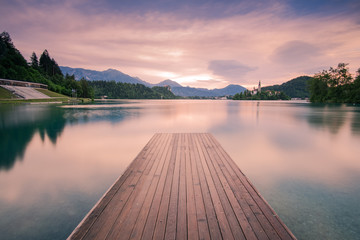Wall Murals Lavender Wooden deck leading into Bled lake,Slovenia