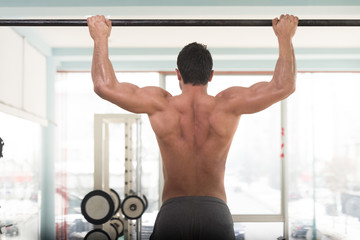 Model Doing Pull Ups Best Back Exercises