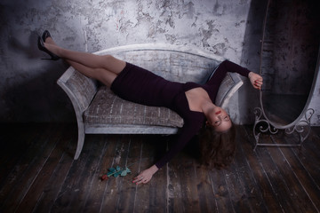 Retro styled fashion portrait of a woman in a dark interior