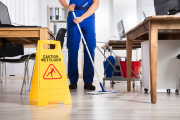 Janitor Cleaning Floor In Office